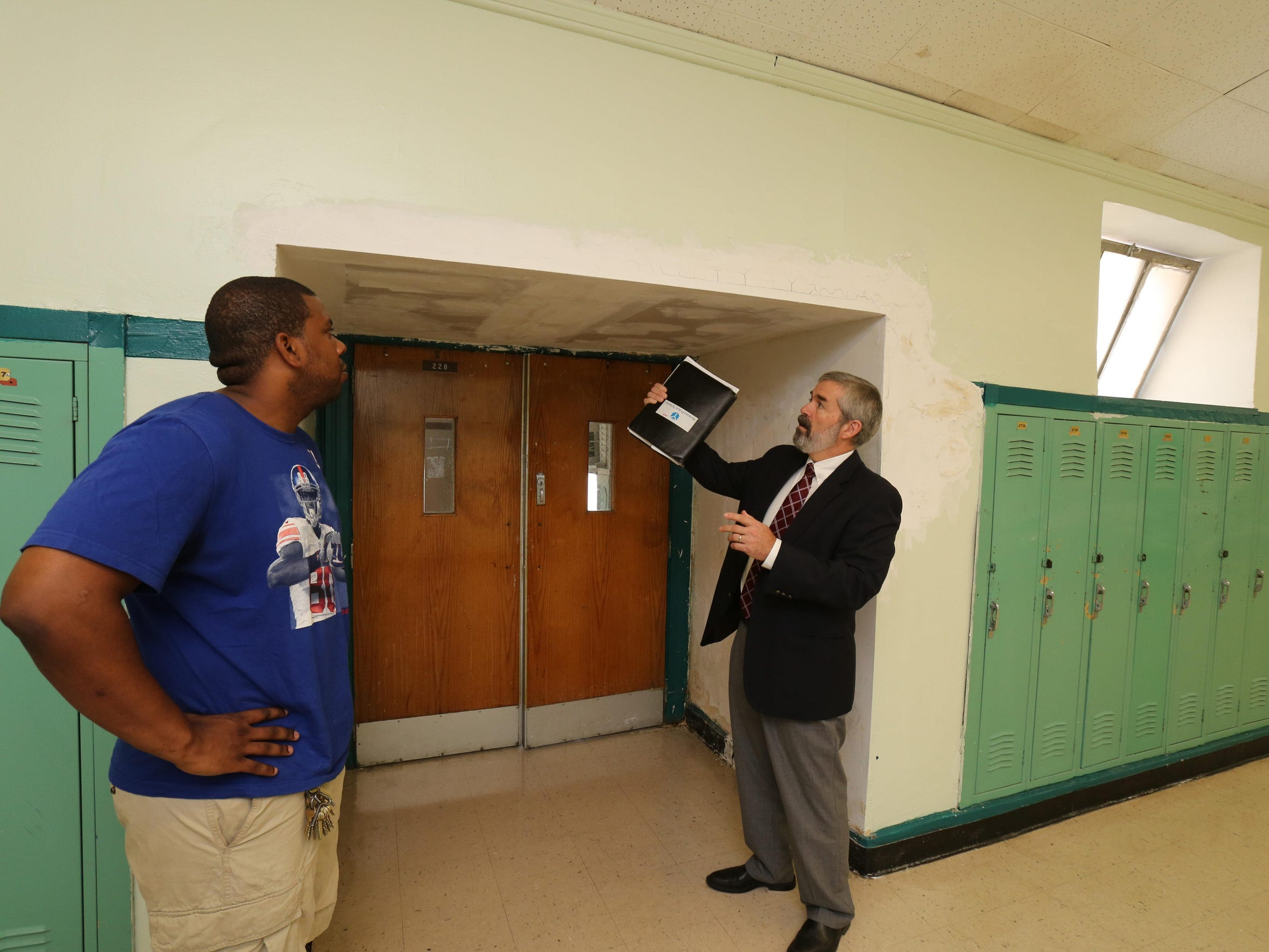 John Carr, right, director of school facilities management