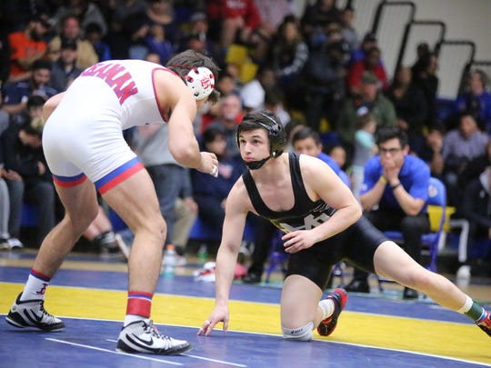 Mission Oak's Jaden Enriquez, right, gets in position against Brett Villarreal, of Buchanan, on Saturday at the CIF Central Section Masters Tournament in Clovis. Enriquez won 3-2 to capture the section title at 138 pounds.