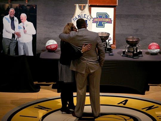 Melvin Daniels Jr. and his wife Connie look over the photos and other Pacers historical items on display for his fathers memorial service. A public memorial service for Indiana Pacers great Mel Daniels was held Thursday, November 5, 2015, afternoon Bankers Life Fieldhouse.