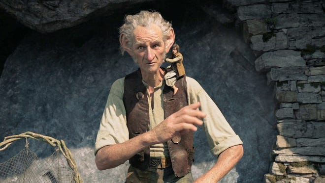 """Mark Rylance is the titular Big Friendly Giant and Ruby Barnhill is his small friend in """"The BFG."""""""