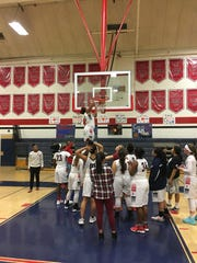 The Coronado girls basketball team cuts down the nets