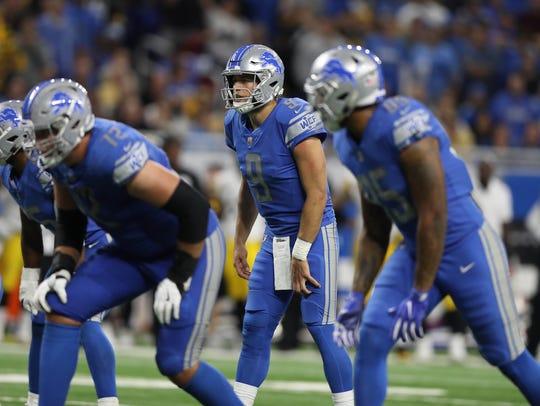 Lions quarterback Matthew Stafford runs a play against