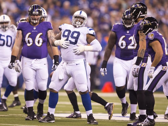 T.Y. McGill rubs his belly after a Colts stop, Colts vs. Baltimore Ravens, preseason at Lucas Oil Stadium, Saturday, Aug. 20, 2016.