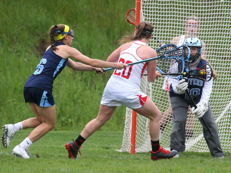North Rockland's Kaitlyn Gutenberger scores past Suffern goalie Shauna Meehan.