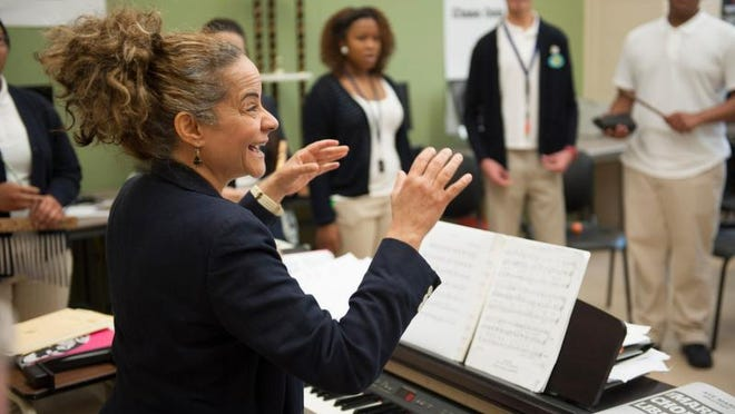 Creative Arts Morgan Village Academy High School Choir Director Suzzette Ortiz rehearses with the choir. She is taking 13 kids—from middle schoolers all the way up to 12th-grade—to an international choir competition in Poland. Monday, June 8, 2015.