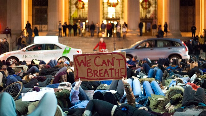 Protesters participate in a die in during the Davis Square March which went from Tufts University, through Davis Square, and down through Cambridge to the Harvard Bridge on December 5th, 2014.