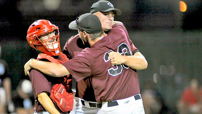2009 Chillicothe Mudcats lefthanded relief pitcher Scott Limbocker (facing camera) is embraced by fellow hurler Chris Williamson (33) as catcher Jason Dennis, left, also arrives at the mound to congratulate the hurler after the University of Arkansas southpaw has retired the final Sedalia batter of the Mudcats' MINK League Championship Series-clinching victory on July 22. Dennis had delivered the hit which drove in the 2-0 win's first run in the eighth inning. It was the Mudcats' second league crown in four years.