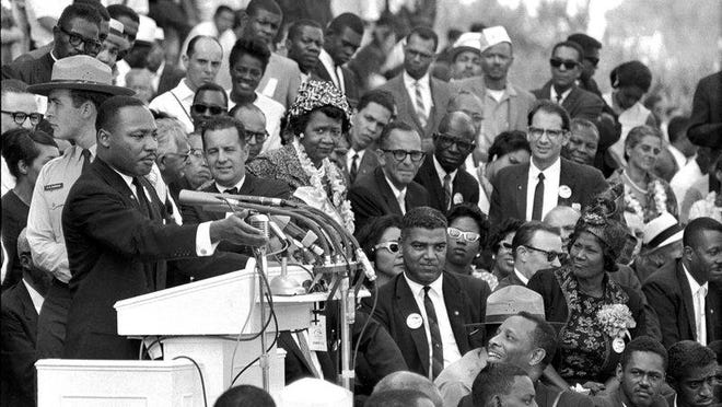 "In this file photo from Aug. 28, 1963, the Rev. Dr. Martin Luther King Jr., head of the Southern Christian Leadership Conference, speaks to thousands during his ""I Have a Dream"" speech in front of the Lincoln Memorial for the March on Washington for Jobs and Freedom, in Washington."