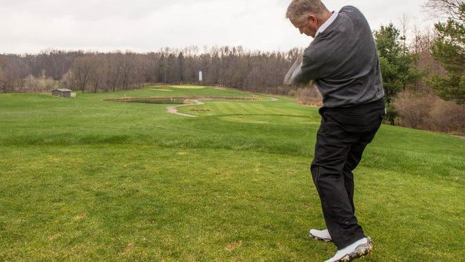 Binder Park head PGA pro and general manager Ron Osborne hits an iron off the tee to stay short of the pond on the No. 1 hole on the Natural course at Binder Park Golf Course.