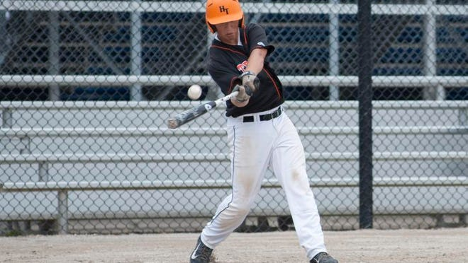Seth Spence of Homer hits the ball in the Mayor's Tournament against Portage during Friday's action.