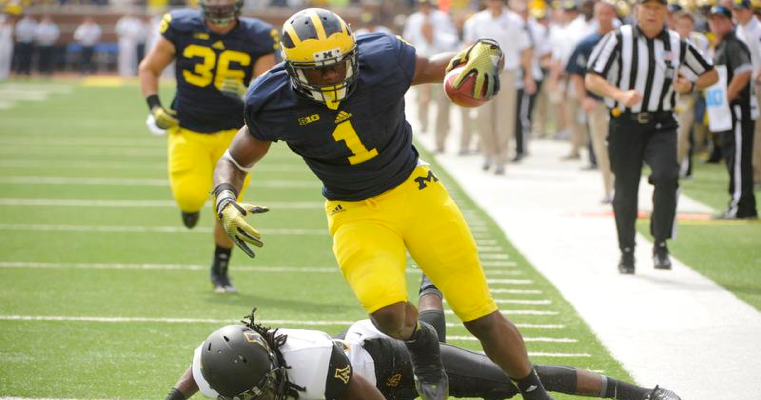 the latest 7f561 35b9c Devin Funchess embraces Michigan's No. 1 jersey