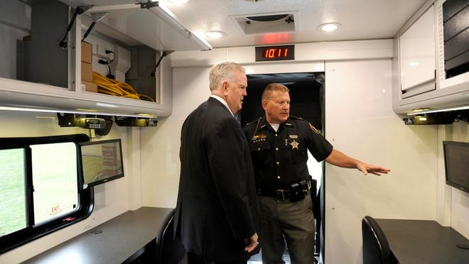 Clerk of Courts Gary Walters tours the Licking County Sheriff's Office's new mobile command unit with Licking County Sheriff Randy Thorp. In 2014, title funds were used to purchase the command unit.