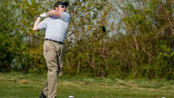 Patrick Gaskin of Sussex Tech High School tees off at Heritage Shores Golf Course.