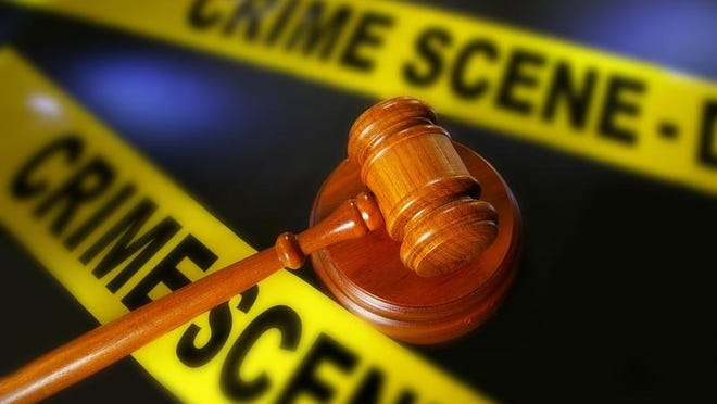Gavel with crime scene tape in the background. canstockphoto.com