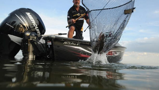 An angler works the net on Mille Lacs Lake.