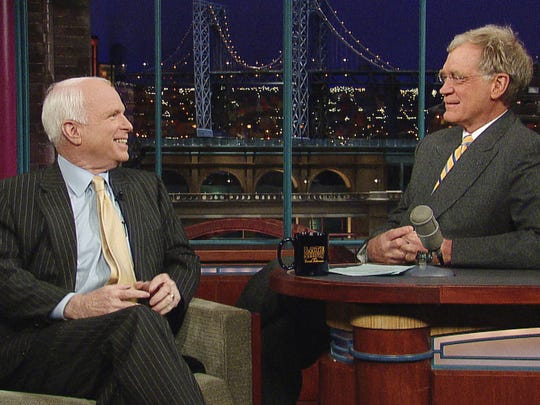 Sen. John McCain (left), R-Ariz., speaks with host