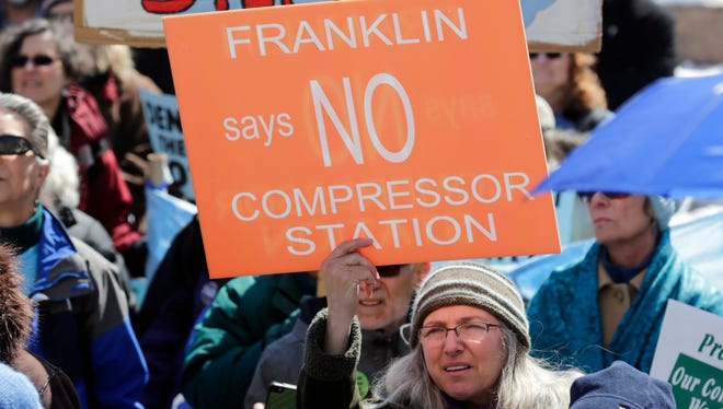 Environmental groups opposing the Constitution Pipeline rally outside the state Capitol on Tuesday, April 5, 2016, in Albany,