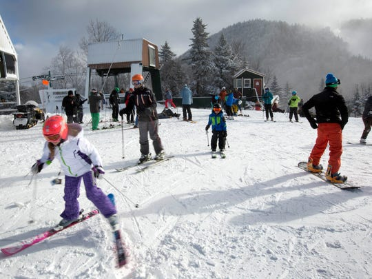 Skiers get ready to take the first run of the season on top of the mountain on opening day at Loon Mountain ski resort Wednesday, Nov. 23, 2016, in Lincoln, N.H. Many ski areas in Northern New England plan to open for the Thanksgiving weekend.