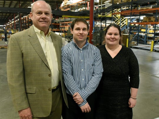 House-Hasson Hardware Co. CEO Don Hasson with his son Taylor Hasson and Carrie Finney in the warehouse area of the Knoxville-based wholesale hardware distributor on Jan. 26, 2016.