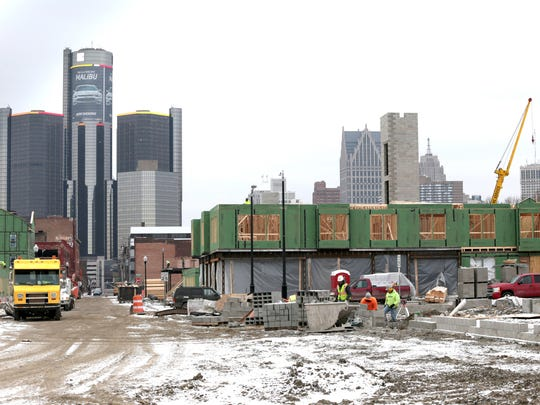 East Riverfront development, Orleans Landing, in Detroit, with the Renaissance Center in the background seen from Franklin street on Thursday, January 21, 2016.
