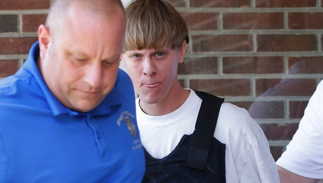 Suspect Dylann Storm Roof is escorted from the Shelby, N.C., Police Department on June 18, 2015.