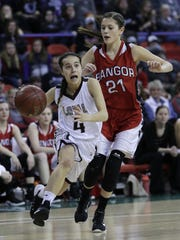 Loyal's Remi Geiger (4) drives to the basket against Bangor's Elizabeth Nicolai (21) during the WIAA Division 5 State Tournament semifinal girls basketball game Friday at the Resch Center.