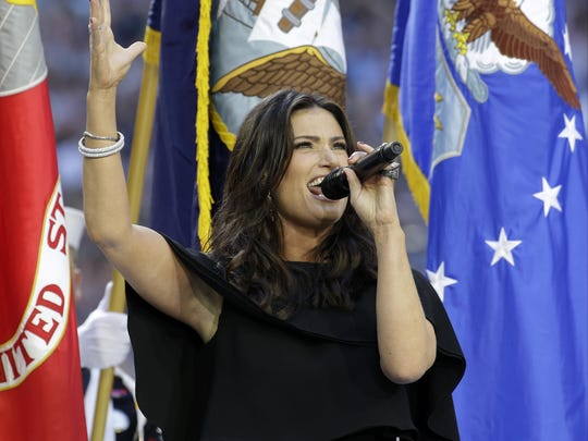 Idina Menzel sings the national anthem before Super Bowl XLIX in Glendale, Arizona, on Feb. 1.