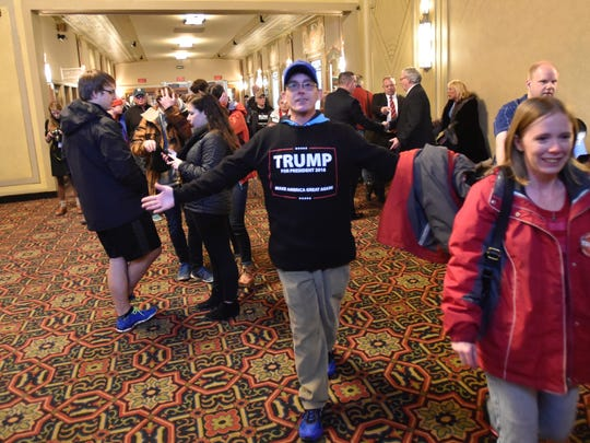 Supporters of Republican presidential candidate Donald Trump enter the Flynn Center in Burlington before speaking there on Thursday night.