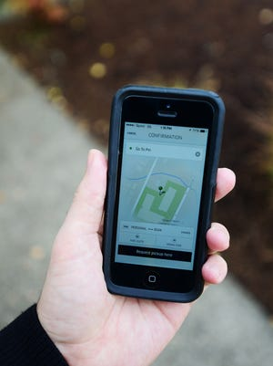 The Uber app as shown from an iPhone in downtown Salem on Monday, Oct. 27, 2014.