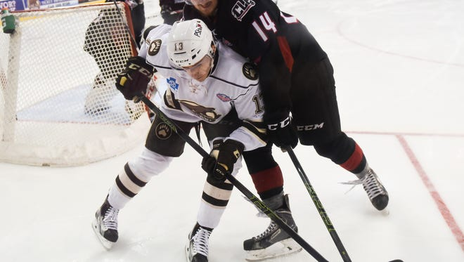 Hershey Bears left wing Jakub Vrana (13) and Lake Erie Monsters defenseman Dean Kukan (14) battle over the puck as the Hershey Bears fell to the Lake Erie Monsters 4-1 in game one of the Calder Cup playoffs at the Giant Center in Hershey, Pa. on Wednesday, June 1, 2016.