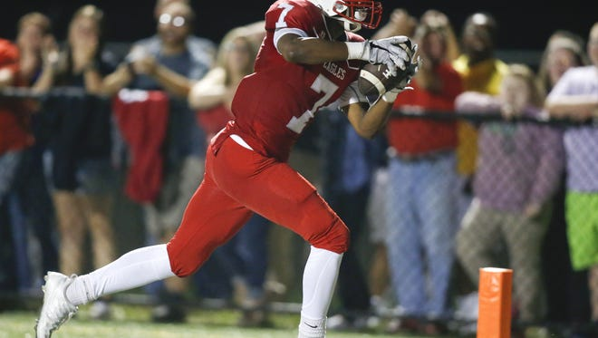 Smyrna's Stephen Whaley, shown here scoring against Salesianum on Sept. 23, caught the winning touchdown pass in the Eagles' 22-14 win at Sussex Central on Saturday.