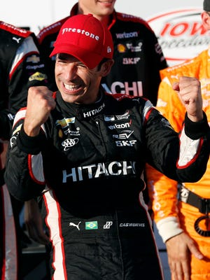 Helio Castroneves, of Brazil, celebrates in Victory Lane after winning a IndyCar Series auto race Sunday, July 9, 2017, at Iowa Speedway in Newton, Iowa. (AP Photo/Charlie Neibergall)