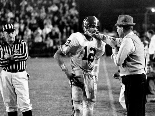 Alabama head coach Bear Bryant talks with quarterback Kenny Stabler (12) during a timeout against Vanderbilt. Sixth-ranked Alabama won the SEC battle 35-21 before 33,407 at Vanderbilt's Dudley Field on Oct. 14, 1967.