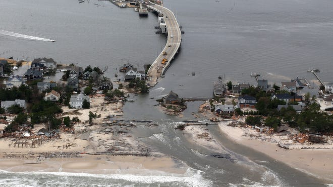 This Oct. 31, 2012 file aerial photo shows storm damage from Sandy over the Atlantic Coast in Mantoloking, N.J.