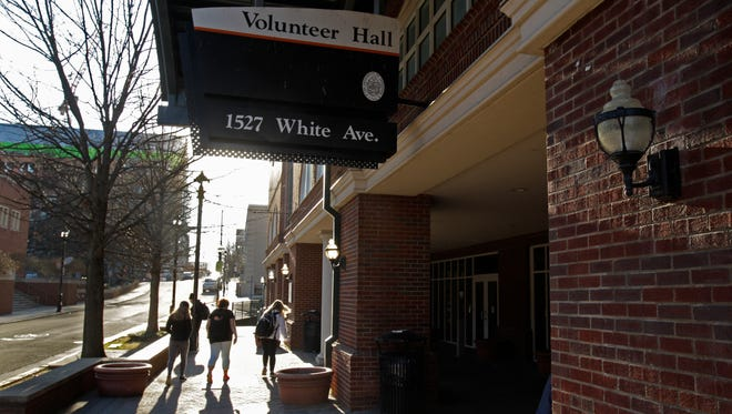 Students walk past Volunteer Hall Friday, in Knoxville.