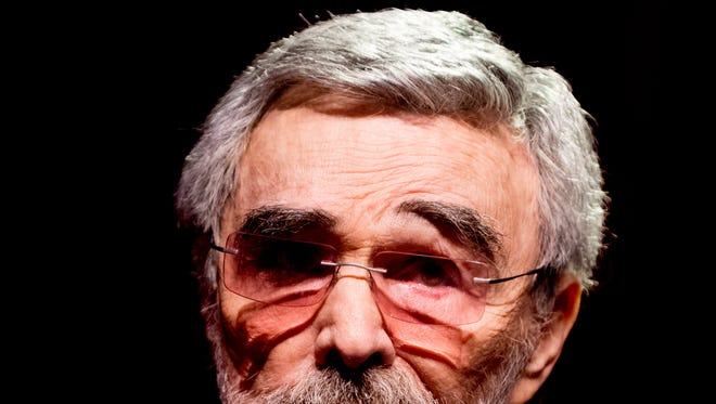 "Burt Reynolds raises his eyebrow while speaking on stage during a red carpet movie premiere for ""The Last Movie Star"" at the Tennessee Theatre in Knoxville, Tennessee on Thursday, March 29, 2018."