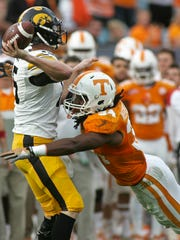 Tennessee's Jalen Reeves-Maybin pressures Iowa quarterback Jake Rudock on Friday. Rudock was 2-of-8 passing for 32 yards, no touchdowns and no interceptions.