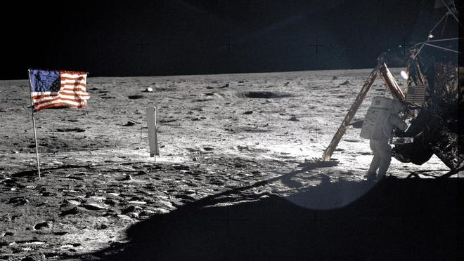 """This July 20, 1969 file photo provided by NASA shows Apollo 11 astronaut Neil Armstrong on the lunar surface. Armstrong and fellow astronaut Edwin """"Buzz"""" Aldrin spent nearly three hours walking on the moon, collecting samples, conducting experiments and taking photographs. In all, 12 Americans walked on the moon from 1969 to 1972."""