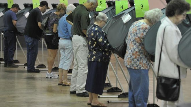Voters line up at voting machines to make their election choices at the Kuhlman Center on the Wayne County Fairgrounds in Richmond in 2012.
