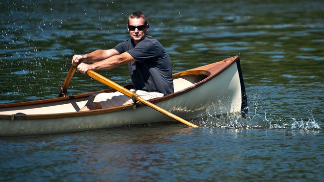 Justin Martin takes out an Adirondack guide boat on the Otter Creek that he and his brother Ian build at their business on U.S. 7 in North Ferrisburgh.