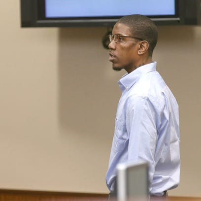 Thomas Johnson lll enters the courtroom for  opening