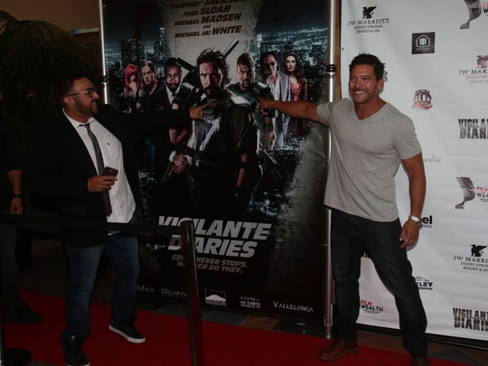 Actor Paul Sloan who plays the vigilante and director Christian Sesma attends a red carpet screening of their film at the Mary Pickford Theater in Cathedral City on Saturday, June 18, 2016.