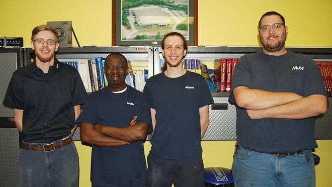 From left, Jesse Philips, of Morning View, Colin Chazuka, of Fort Mitchell, Matt Ryan, of Hebron, and Joey Baxter, of Petersburg. Now full-time employees at Mubea, they came up through the auto parts manufacturing company's apprentice program.