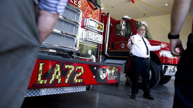 Then-Greater Naples Fire Rescue District assistant chief Nolan Sapp speaks to a crowd of supporters as the Ladder 72 and Squad 72 trucks are initiated into active duty during a push back ceremony at Station 72 Thursday, May 5, 2016 in Naples. (Luke Franke/Staff)