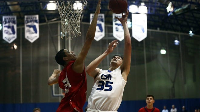 Westminster Academy Paul Atkinson blocks a layup attempt by Community School junior Trent Buttrick during the 3A regional final at Community School of Naples on Saturday, Feb. 20, 2016. Community School of Naples lost with a final score of 87-64. (Dorothy Edwards/Staff)