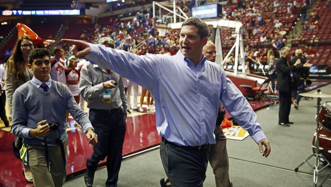 Florida Gulf Coast Eagles head coach Karl Smesko points to a familiar face after downing Oklahoma State Saturday, March 21, 2015 at Florida State's Donald L. Tucker Civic Center in Tallahassee, Fla. Florida Gulf Coast faced Oklahoma State during the first round of the Women's NCAA Division I Basketball Tournament. FGCU defeated OSU 75-67 for their first tournament win in program history. (Corey Perrine/Staff)