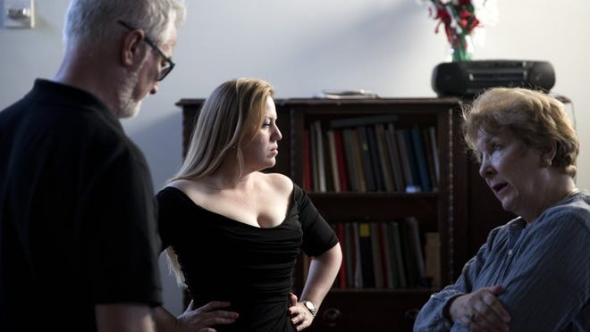 """Elizabeth Caballero, center, being fitted for her role as Violetta, a young courtesan, in the last Opera Naples production of  """"La Traviata"""" in 2016 with staging director James Alexander, left, and costumiere Judy Hushon. The opera, considered one of the 10 best of all time by some critics, returns this year. (Luke Franke/Staff)"""