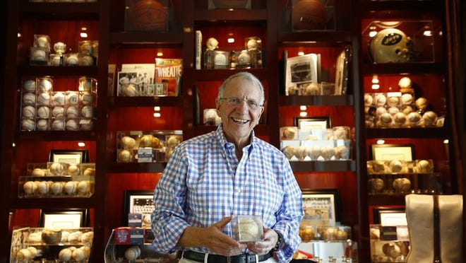 Jay Baker, retired president of Kohl's department store, is shown in portrait with his collection of sports signatures on balls, pictures and equipment Tuesday, April 26, 2016 at his penthouse home in Naples, Fla. Baker is an avid seeker of Yankees memorabilia. He is perhaps Naples' most prominent philanthropist-giving millions to create an art museum, playhouse and park, among other gifts. (Corey Perrine/Staff)