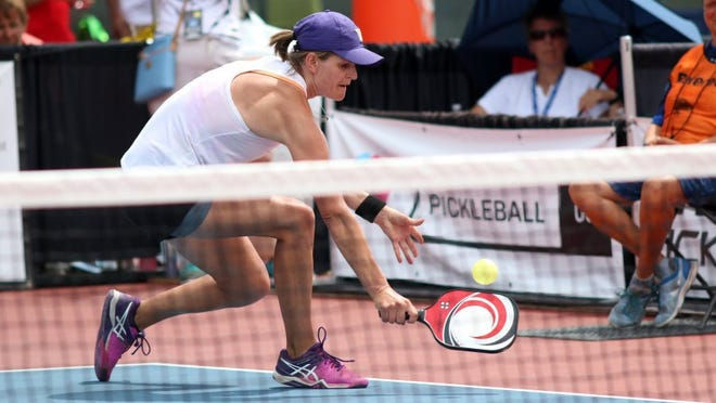 Irena Tereschenko reaches to hit the ball during the Pickleball Championships at East Naples Community Park on Sunday, May 1, 2016. (Kelli Krebs, Staff)