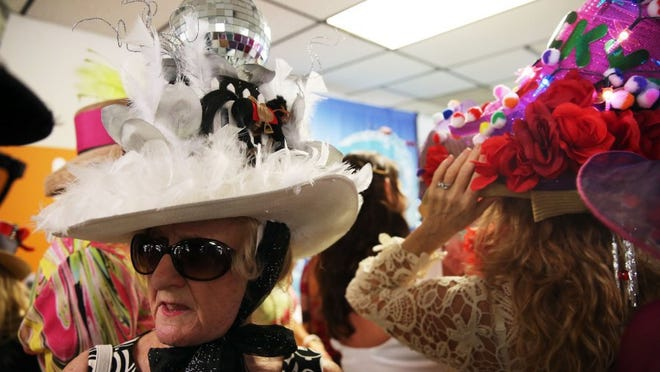 Nancy Dailey of Fort Myers waits for the results during the derby hat contest at the Naples-Fort Myers Greyhound Track in celebration of the Kentucky Derby on Saturday, May 7, 2016. Dailey won first place in the contest. (Dorothy Edwards/Staff)